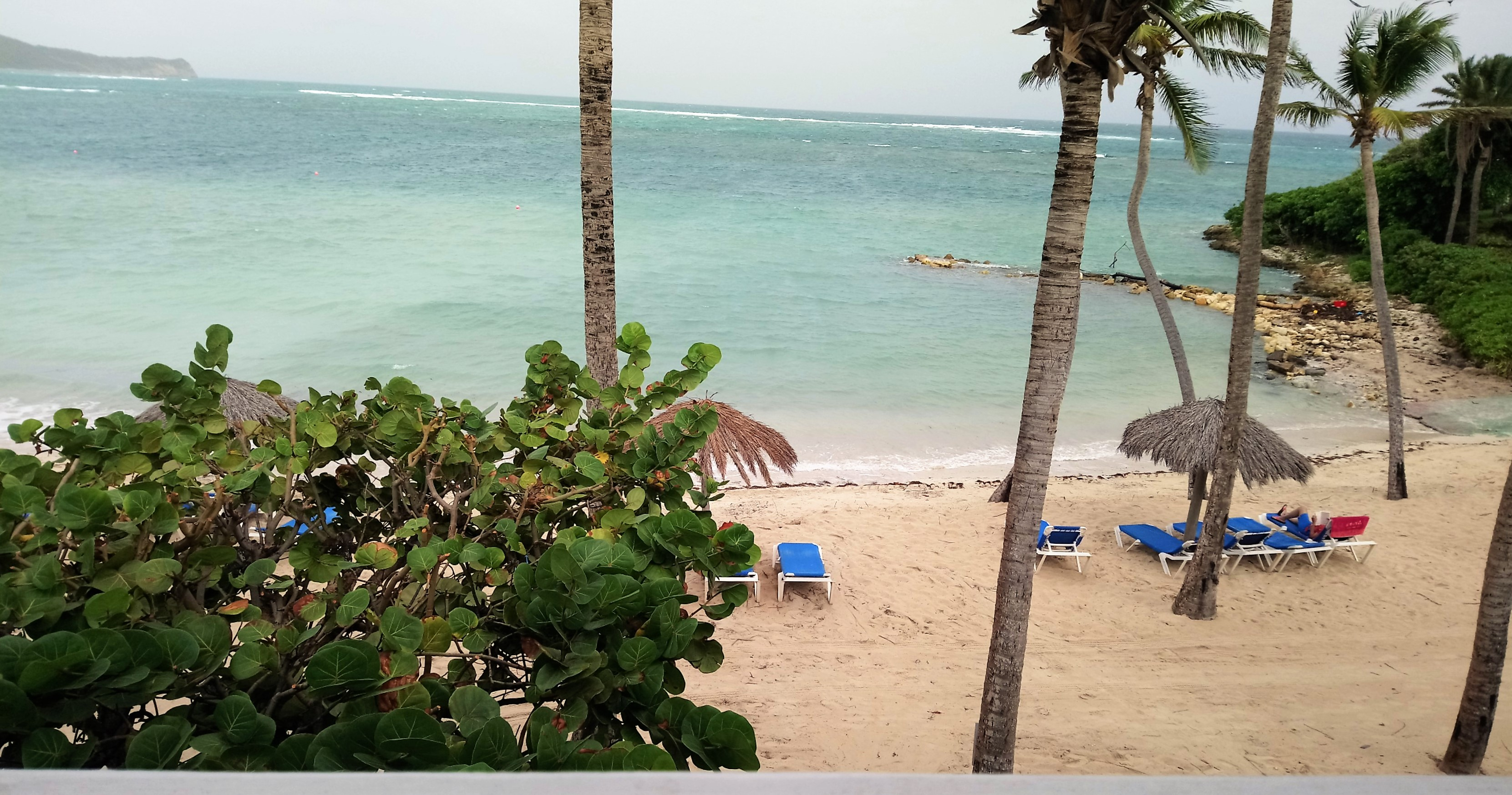 Balcony view of Coco Beach from a Beachfront Room at St James Club Antigua