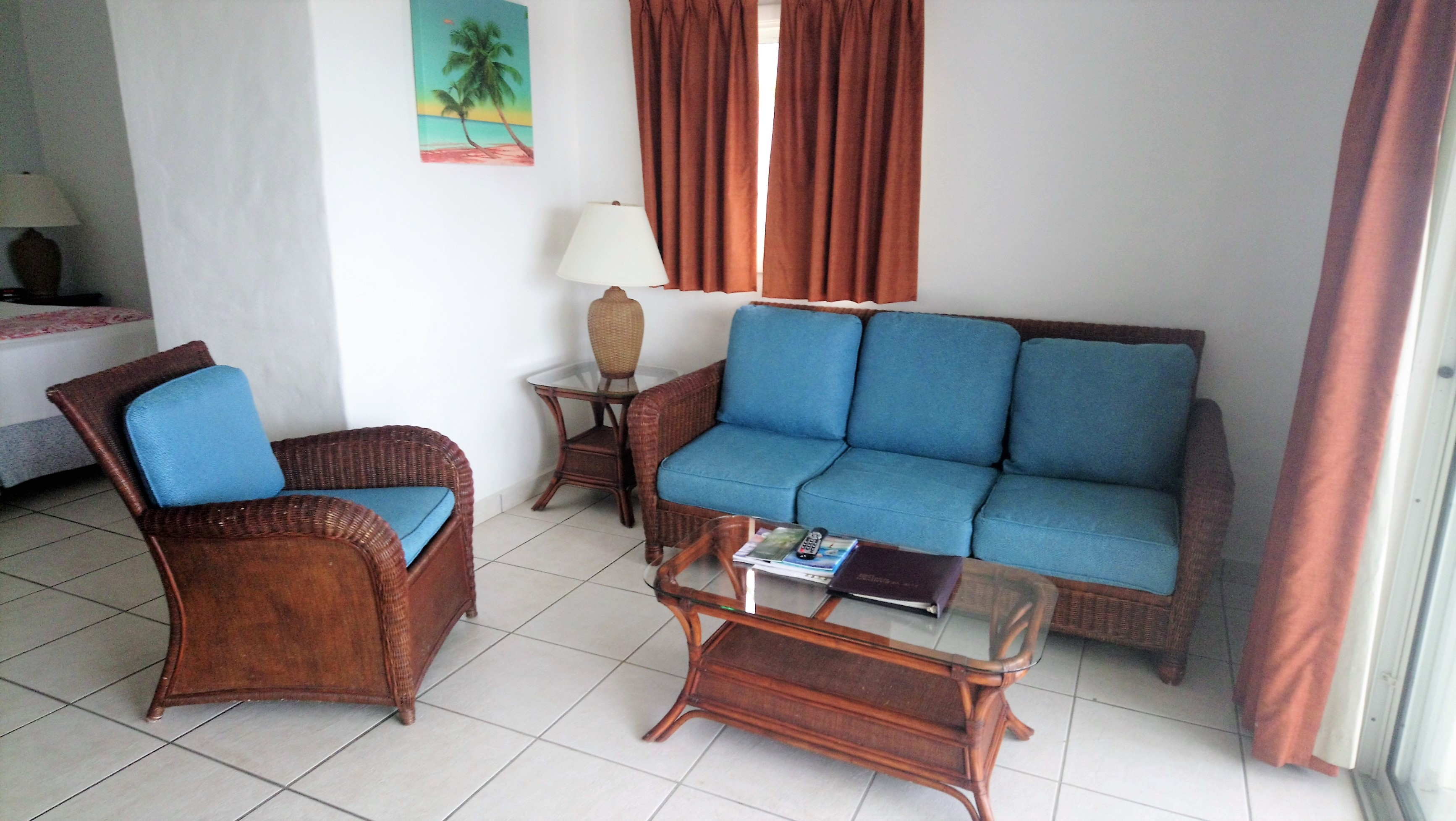 View of the living area in a Wwaterview Suite at The Verandah Resort Antigua