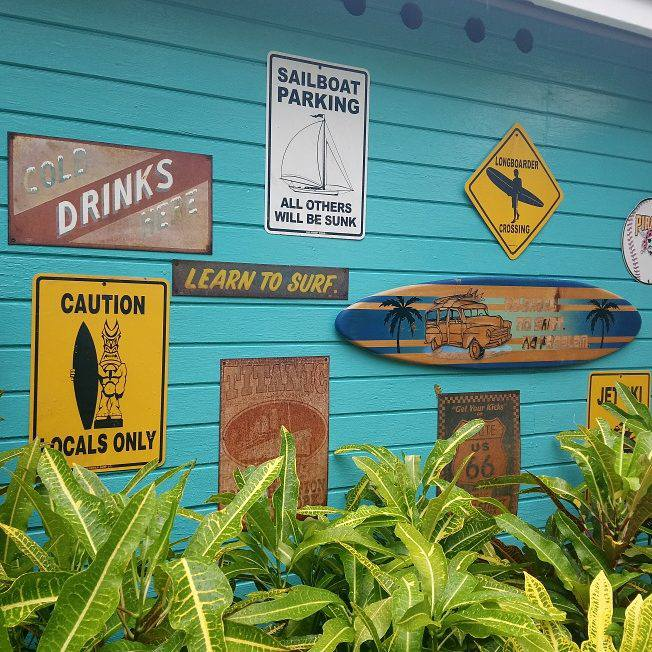 Signs on the side of the Rasta Bar at The Verandah Resort in Antigua