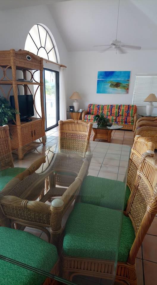 Dining area and lounge inside a two bedroom villa at St James Club Antigua