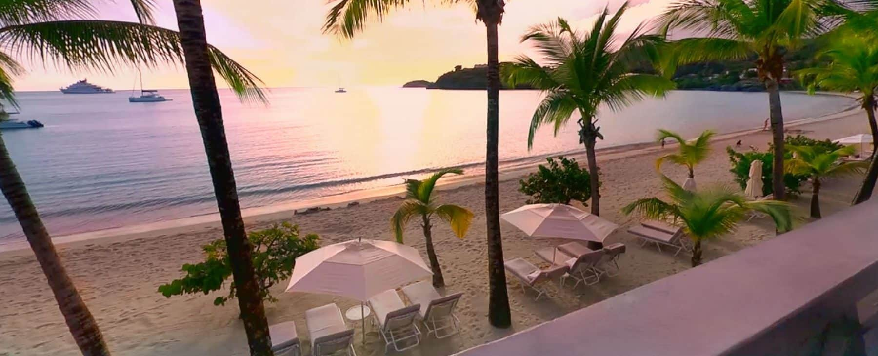 View of the beach with sun loungers at Carlisle Bay in Antigua