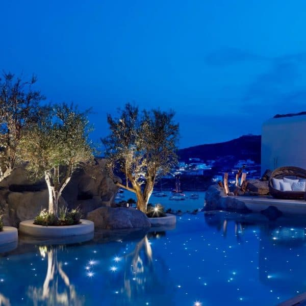 View of the swimming pool at night at Kensho Boutique Hotel in Mykonos, Greece