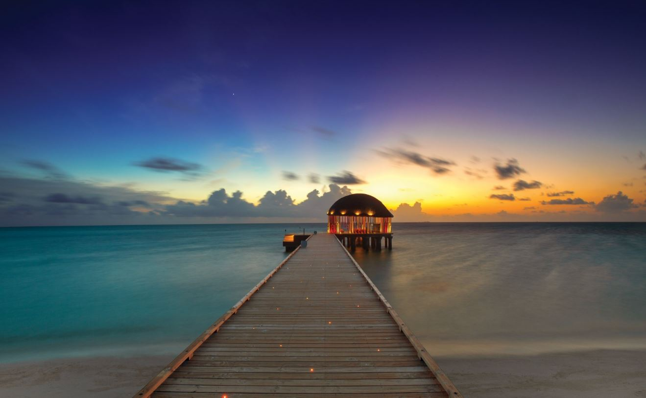 Sunset over the jetty at OZEN by Atmosphere at Maadhoo, Maldives