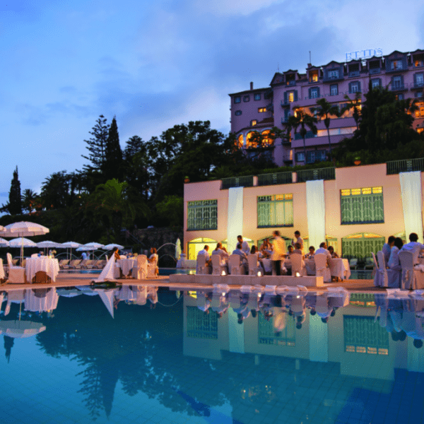 Dining by the pool at Belmond Reids Palace in Madeira