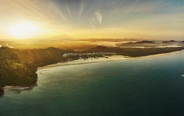 Sunset aerial view of Shangri-La Rasa Ria Resort & Spa in Borneo, Malaysia.