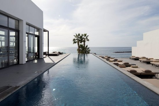 Swimming pool overlooking the sea at Almyra Hotel in Paphos, Cyprus